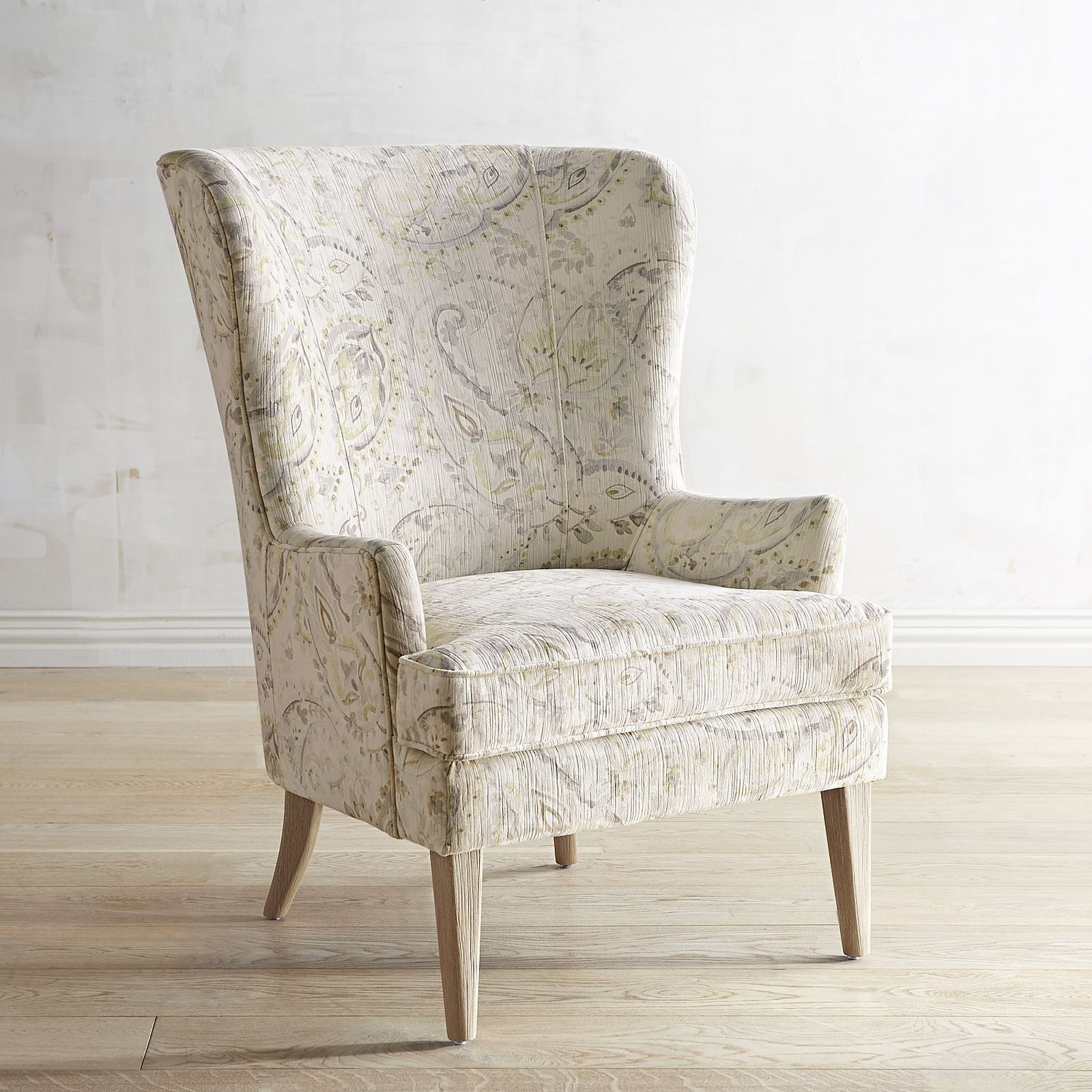 Asher wingback chair from Pier 1. Love the curved back
