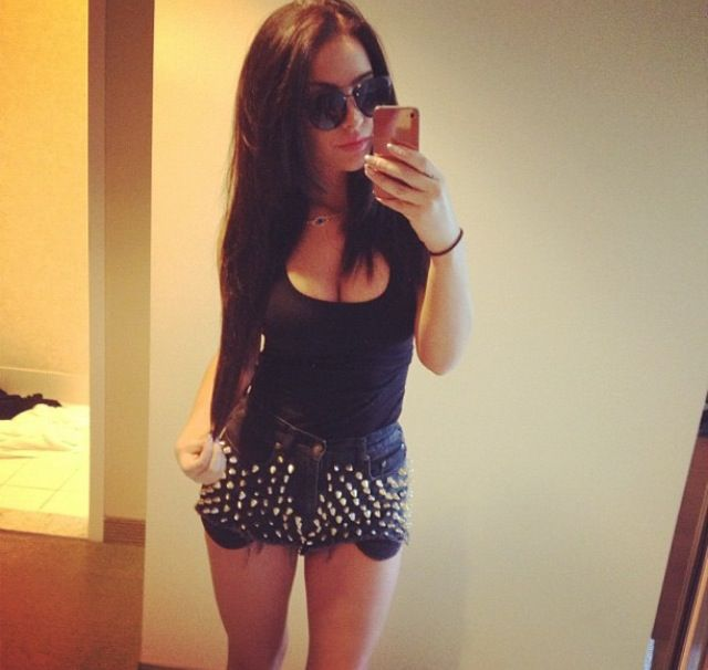 This is so cute how she paired the bling shorts with a black top love!!