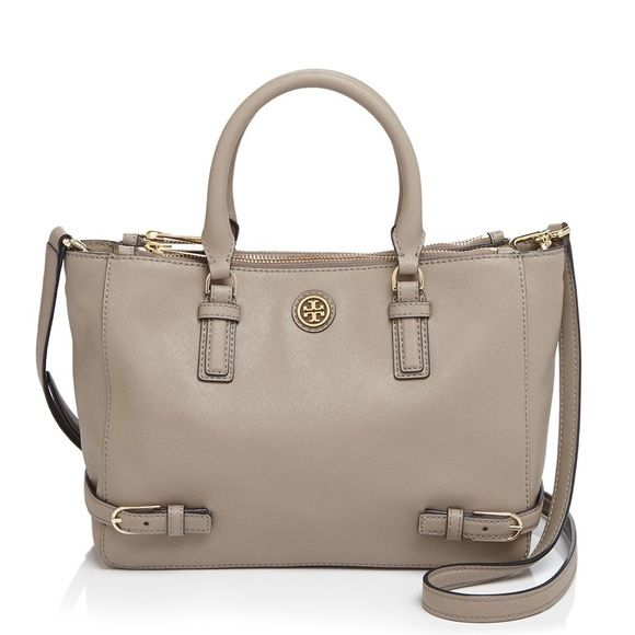 "Tory Burch Robinson SMALL multi tote AUTHENTIC This super cute satchel holds a large wallet, a phone, a cosmetic case and a 10"" tablet.  Made of classic Saffiano leather. Zipper closure compartments at front and back. Open center compartment with magnetic snap closure. Open center compartment features interior zipper pocket and two open pockets. Tubular double top handles with 4.38"" drop. Removable, adjustable cross-body strap with 22.91"" drop. Size: Height: 7.97"",  Length: 10.76"", Depth…"