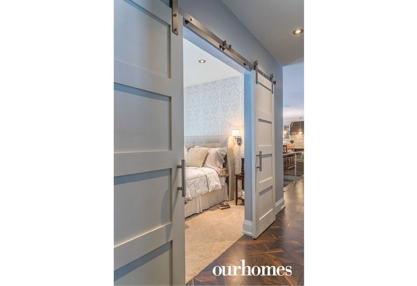 space saving four panel shaker doors glide silently on a barn door track