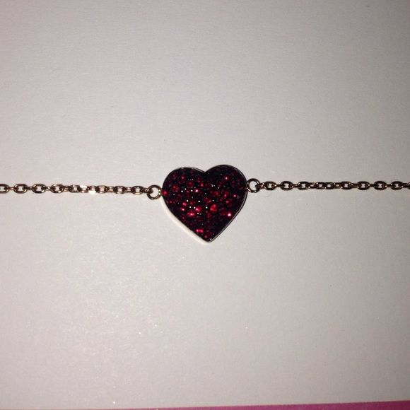 Micheal Kors heart bracelet Micheal Kors heart bracelet, Rose gold, black back with pink diamonds, 7 inches long when unclasp. Michael Kors Jewelry Bracelets