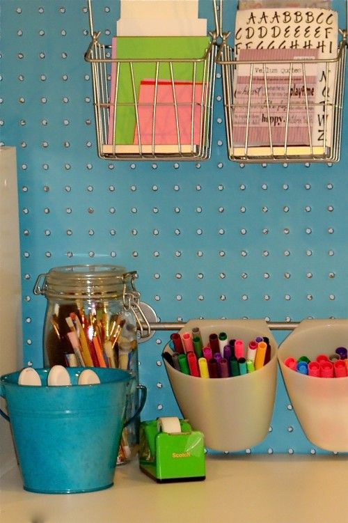 Painted peg board, plastic hanging containers and great organization for craft supplies.  In a closet, or playroom for kids...