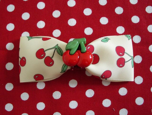 Cherry bow. So adorable I can hardly stand it. I would put it on a bracelet or a belt. Or my purse.