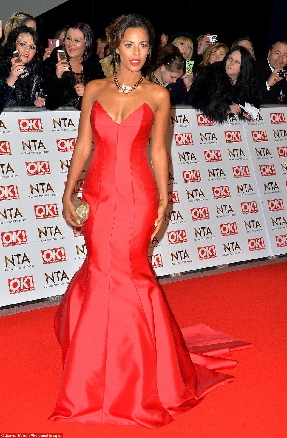 Red alert: The mother-of-one looked sensational in the form-fitting dress which showcased ...