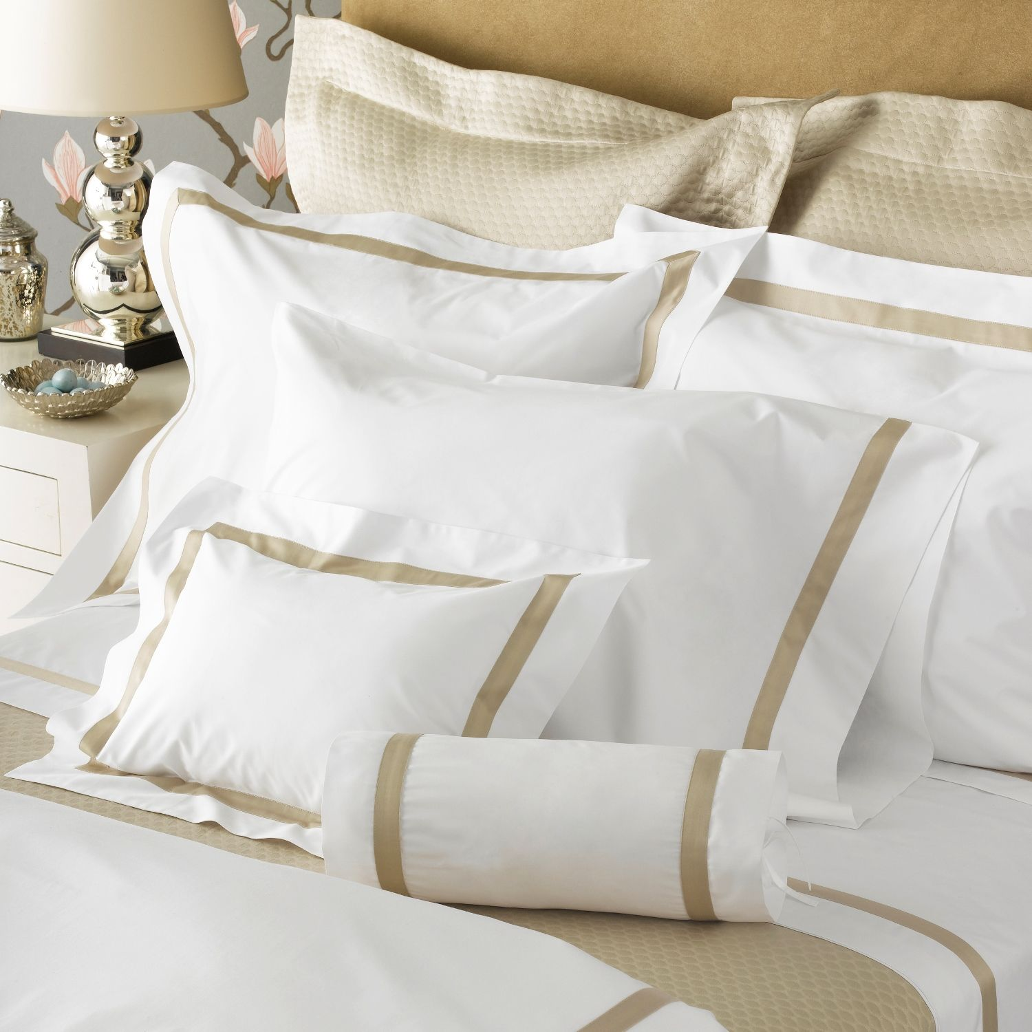 Matouk's iconic, best selling style is an elegantly modern bedroom staple—white or ivory percale sheeting lavishly woven in Italy from the finest Egyptian cotton, finished with a distinctive 1-inch trim in a variety of colors.