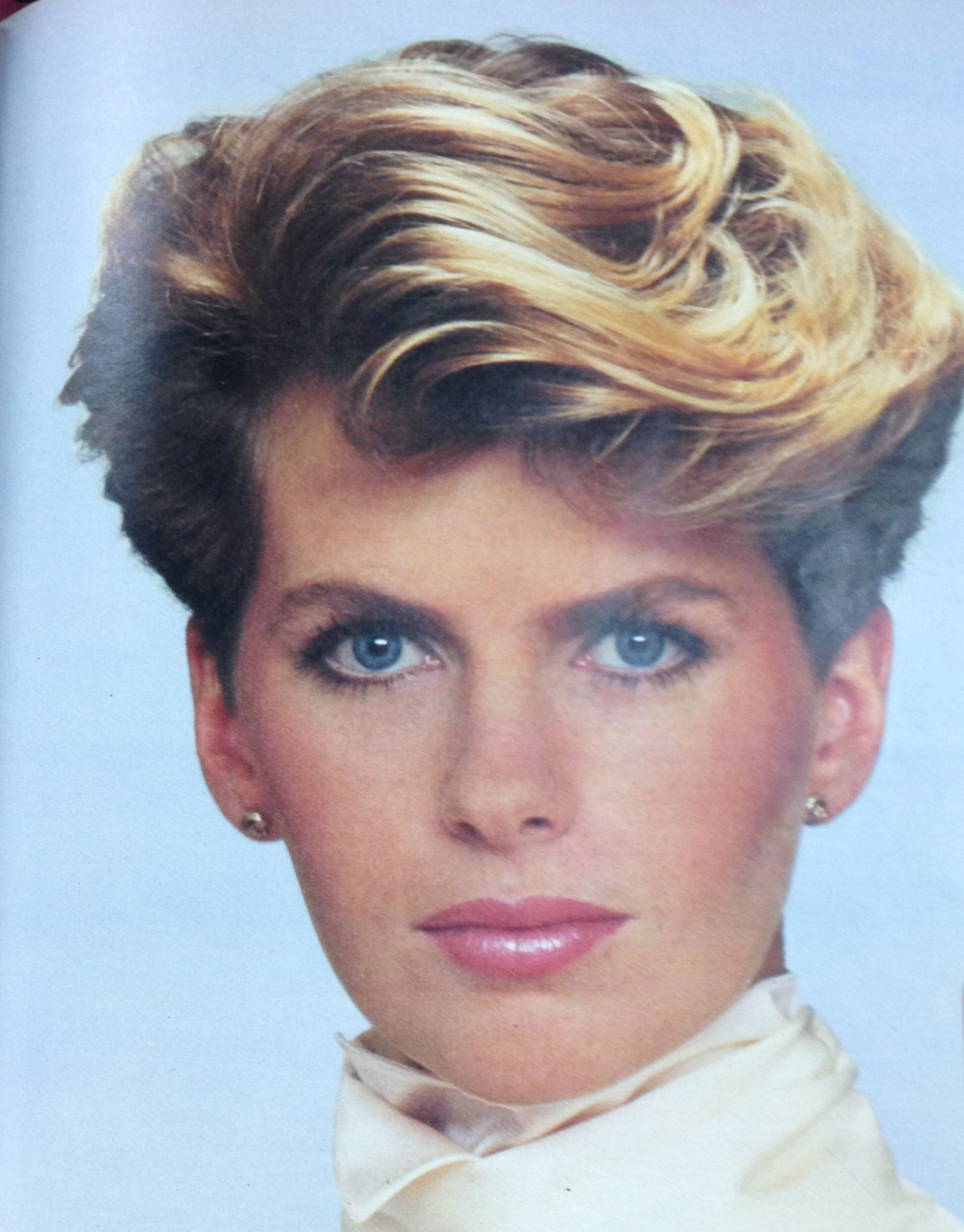 1980's Wavy, short hairstyle.