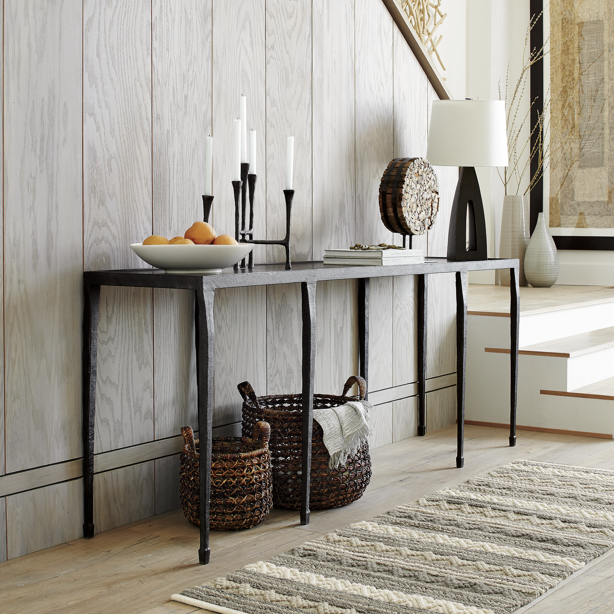 Inspired by 20th-century modernist art, Silviano refines the rustic character of cast iron on a grand scale, accented with sculptural detailing and the artisanal appeal of textured metal.