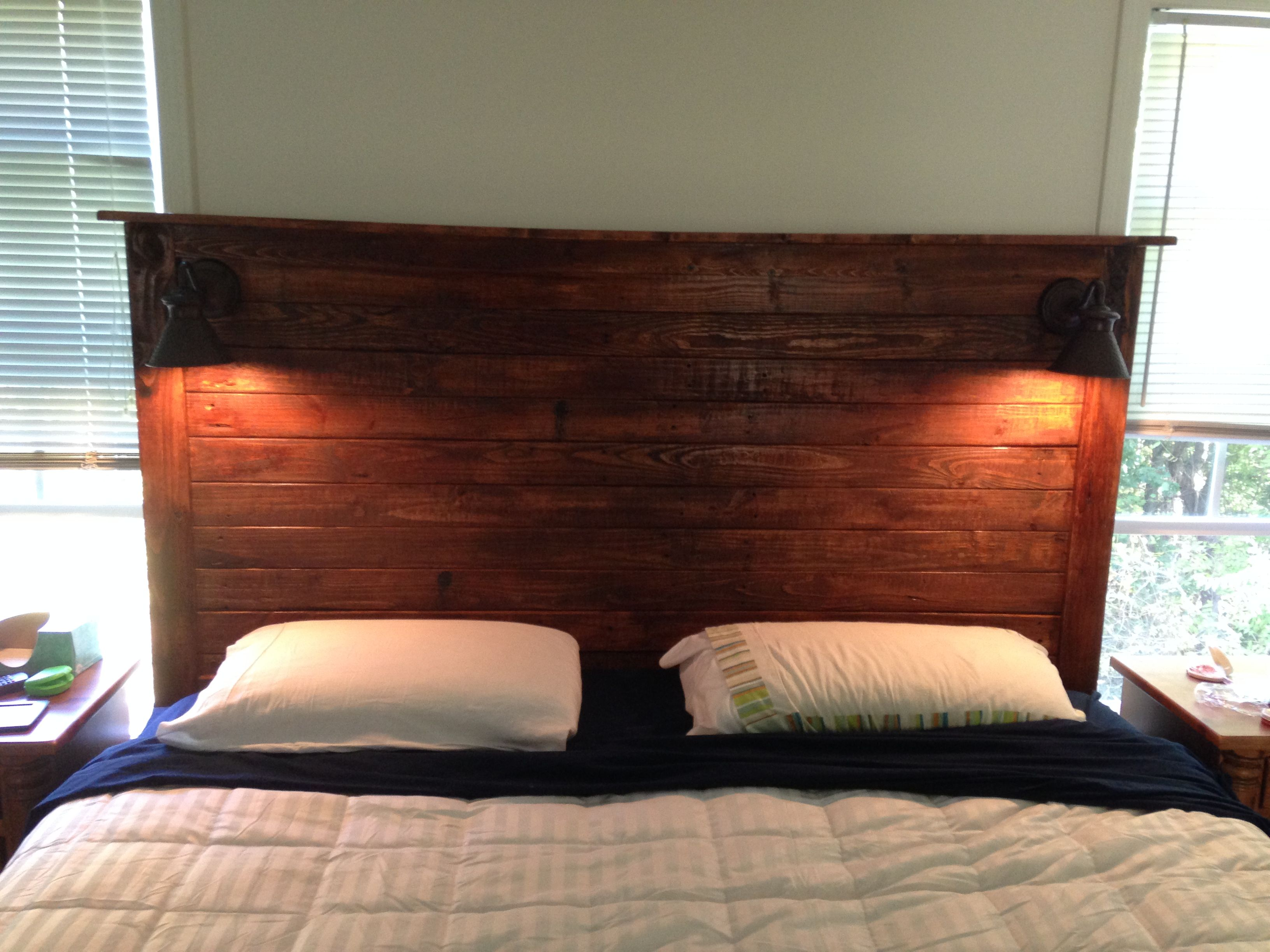 King size headboard made from the pallets that the bed arrived on