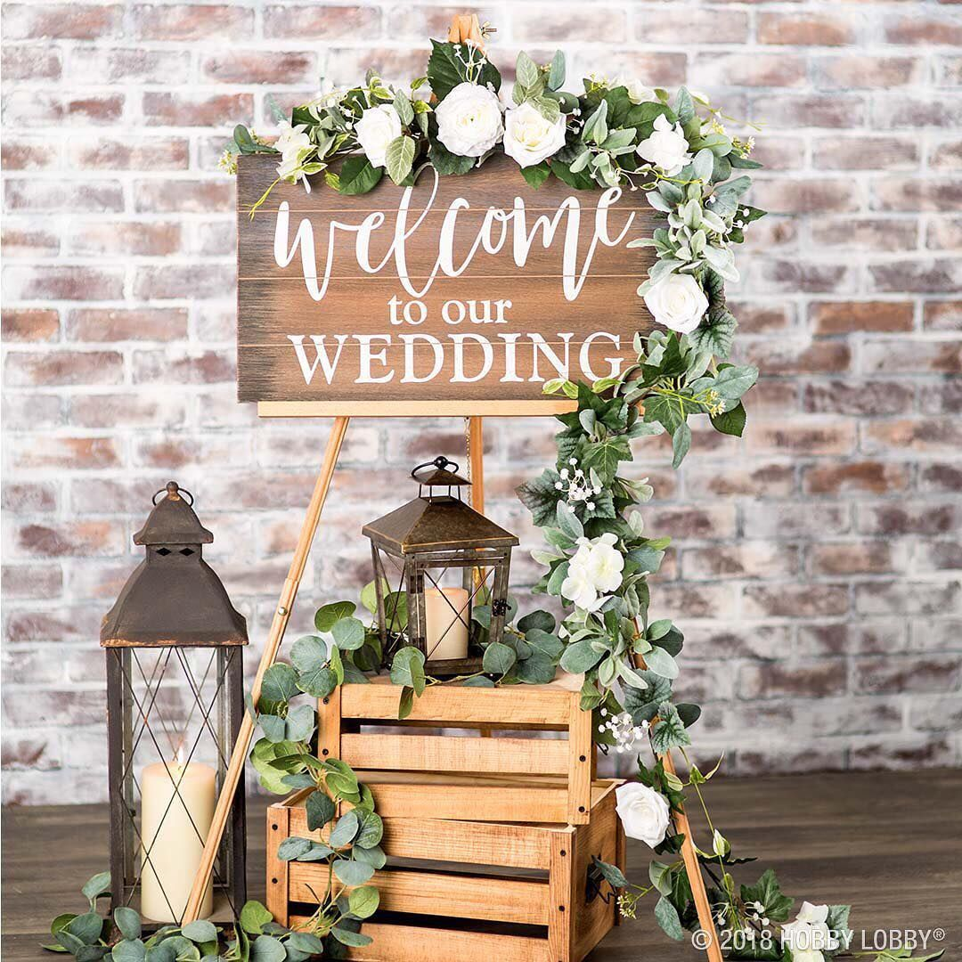Welcome your wedding guests with an elegant display! For more wedding ideas, tap the link in our bio! #HobbyLobbyStyle #WeddingDecor #decorationentrance