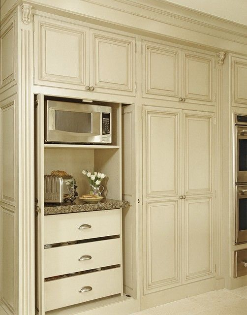 I love the idea of hiding the microwave, toaster, and toaster oven in the cabinets. They would need to be wired for electricity.