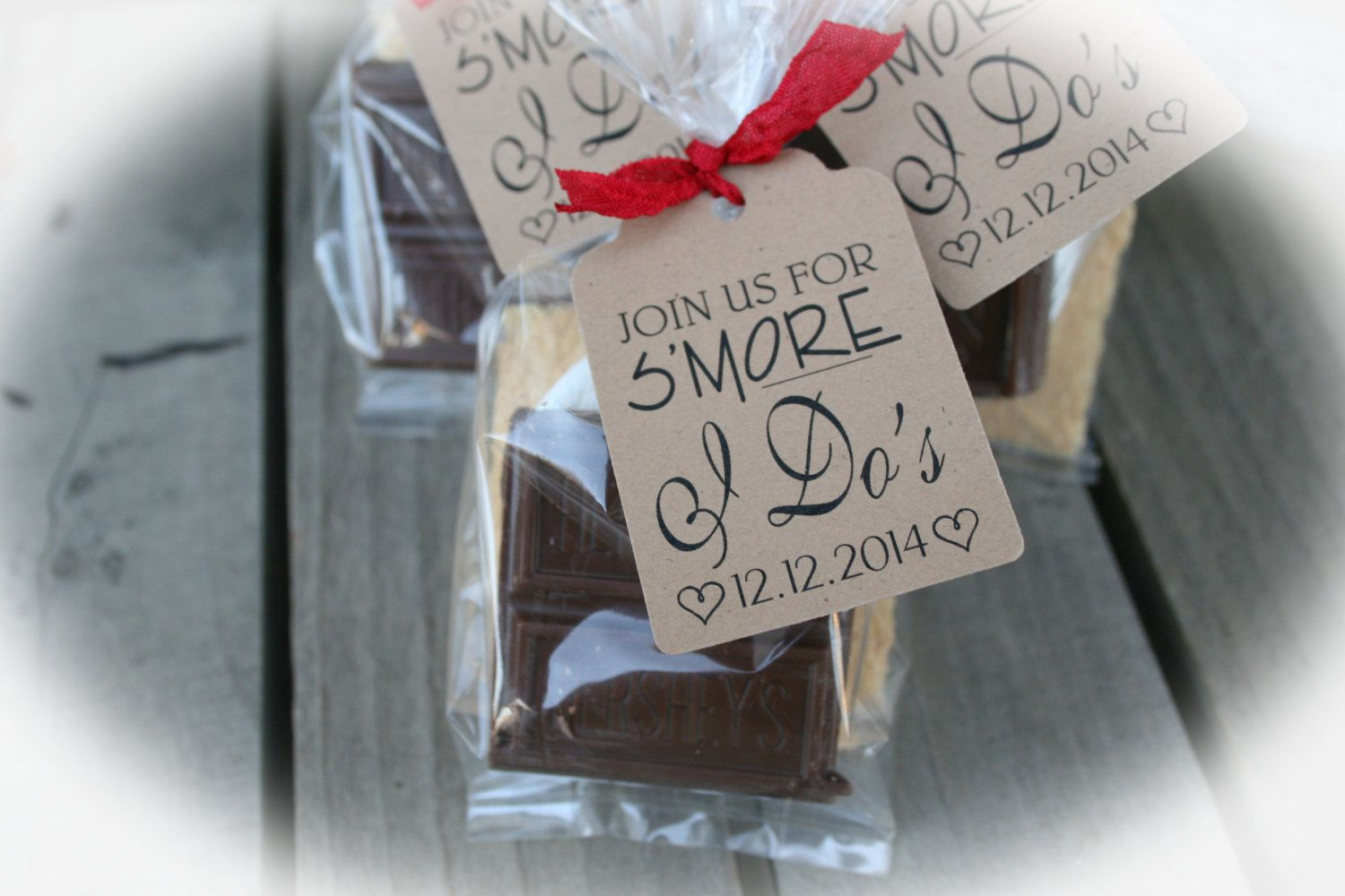 DIY favor kits for SMores favors at your bridal shower. Each tag cut from a kraft cardstock and includes the personalized upcoming wedding date of