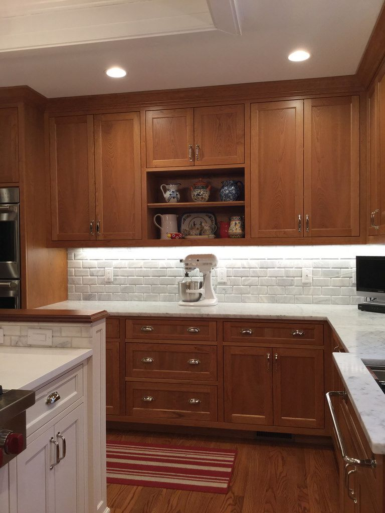 natural cherry cabinets, carrara marble counters, polished nickel ...