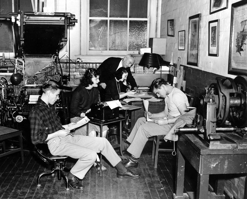 Unidentified students at Rochester Institute of Technology's Department of Publishing and Printing work with Joseph Sorace on a project. 1950.