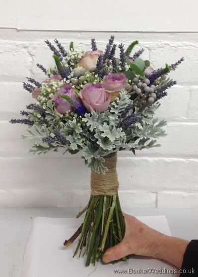 Just Picked but Neat Hand Tied Bridal Bouquet of Lilac Rose, Veronica, Gypsy Grass, Brunia Berries, Grey Senecio Leaves and Lavender tied with twine Side View Wedding Flowers Liverpool, Merseyside, Bridal Florist, Booker Flowers and Gifts, Booker Weddings