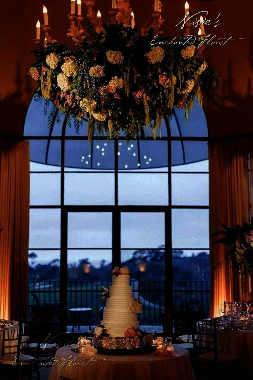 are idyllic for Nisies team to floralize   Nisies Enchanted Florist  Pelican Hills chandeliers are idyllic for Nisies team to floralize   Nisies Enchanted Florist nisiese...