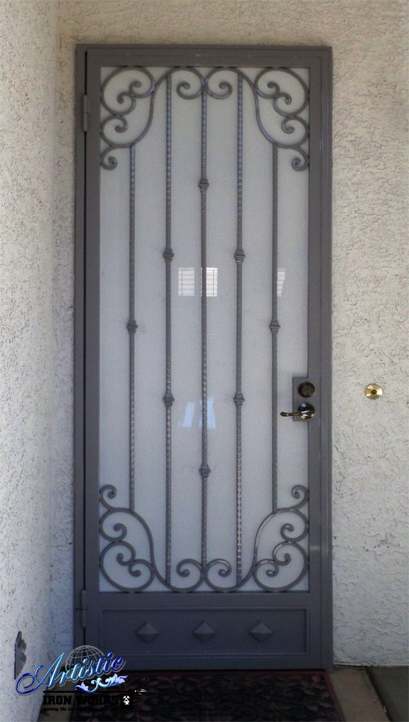 Wrought Iron Security Screen Door With Scrolls And A Kickplate