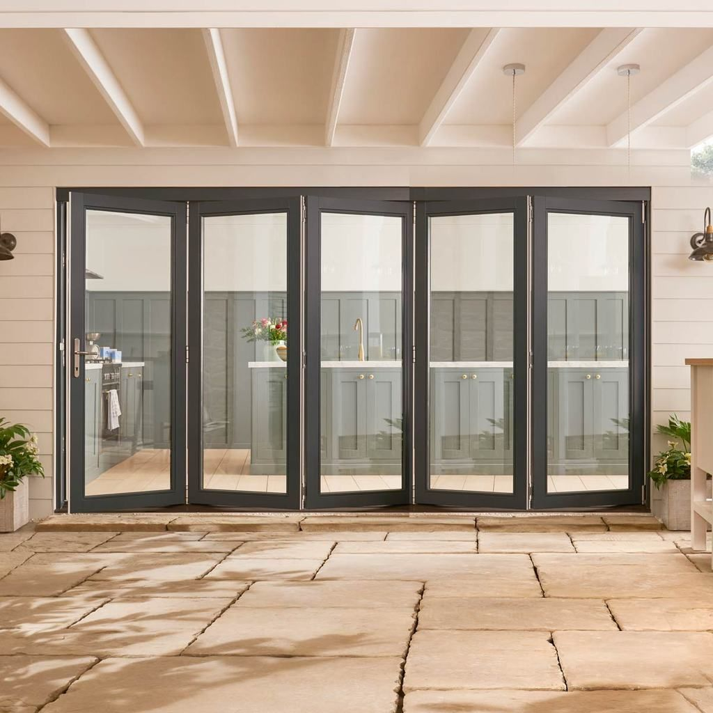 Jeldwen Bedgebury Grey 5 0 Folding Patio Doorset Clear Double Glazing Fully Finished Folding Patio Doors Garage Door Design Folding Doors