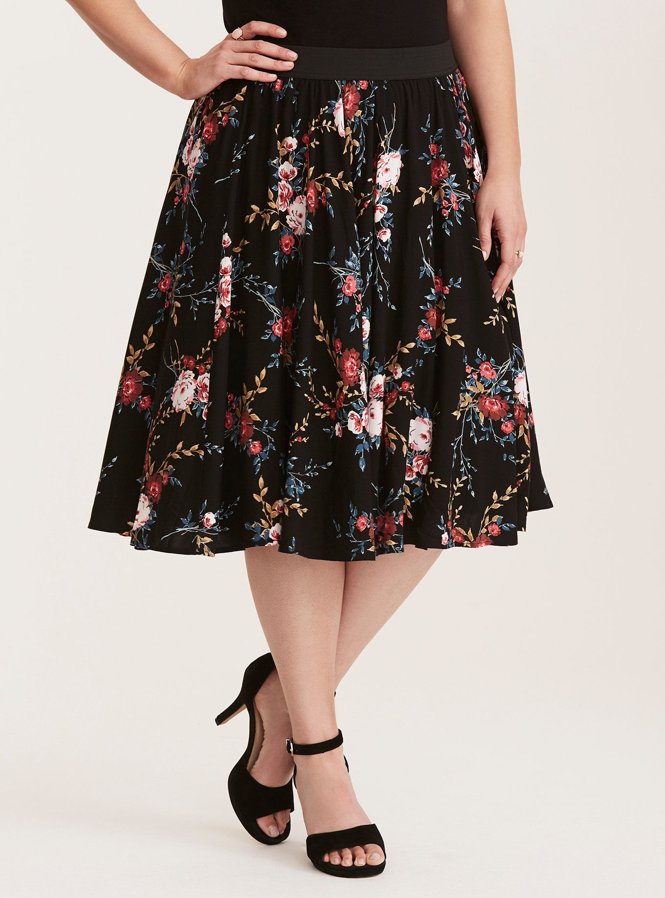 01098f0a8e0a44 This black floral print challis midi skirt certainly has swing to spare  with a fully lined underlay that's been poofed out by tulle ...