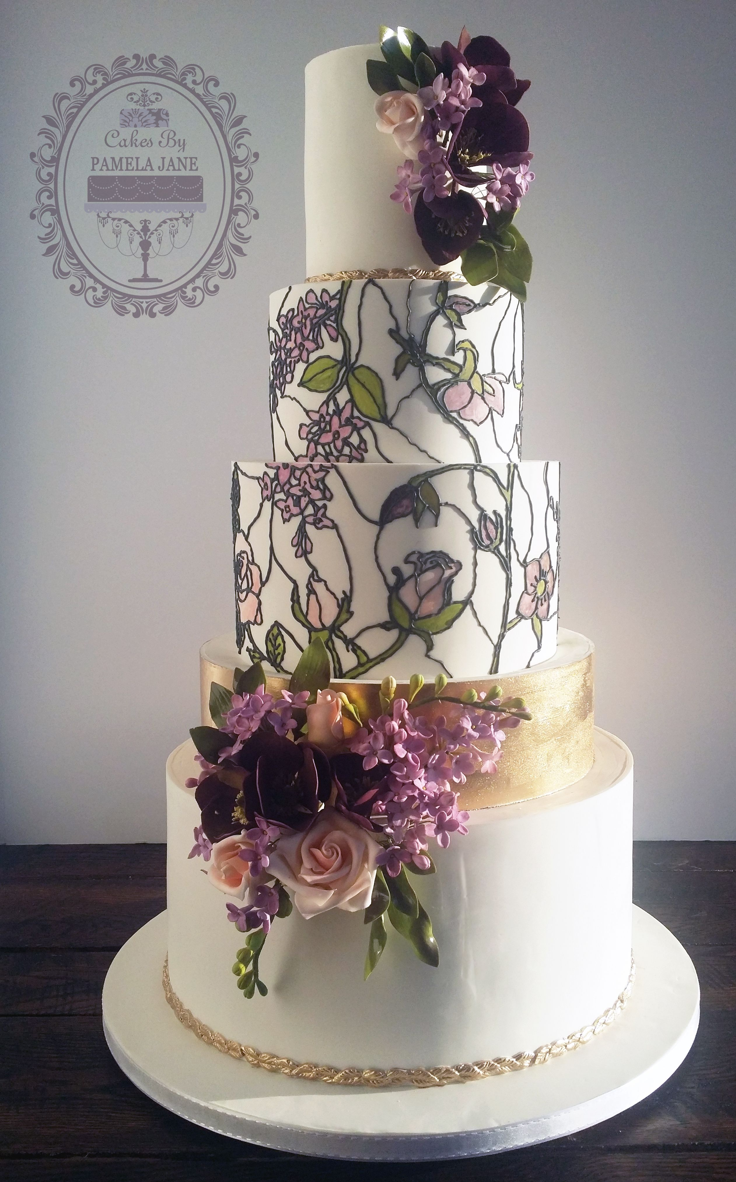 Hand painted stained glass effect wedding cake with gold accents and gumpaste lilacs roses