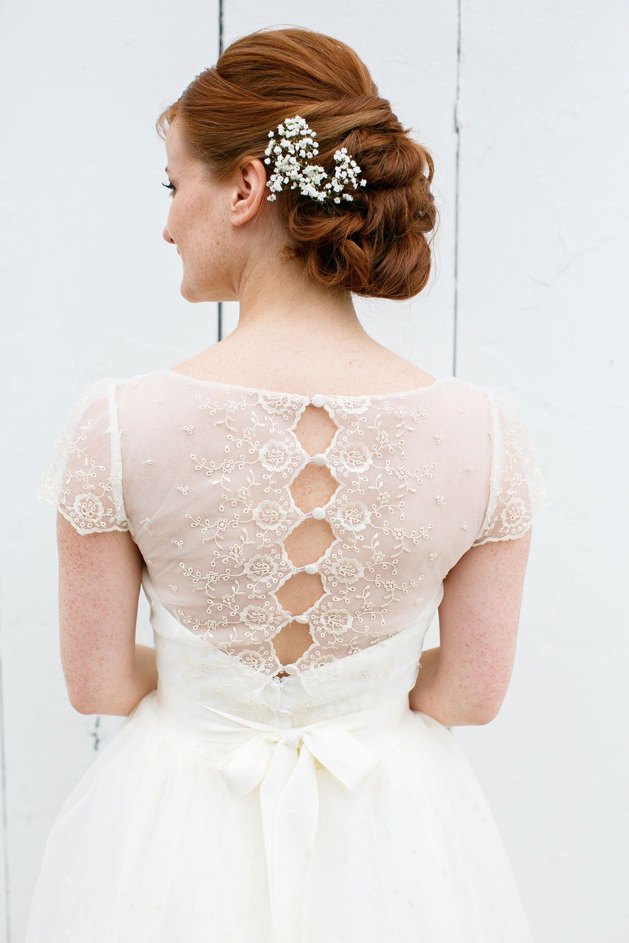 David's Bridal bride Kaitlyn chose a romantic cap sleeve lace gown with scalloped bodice detail for her farm wedding.