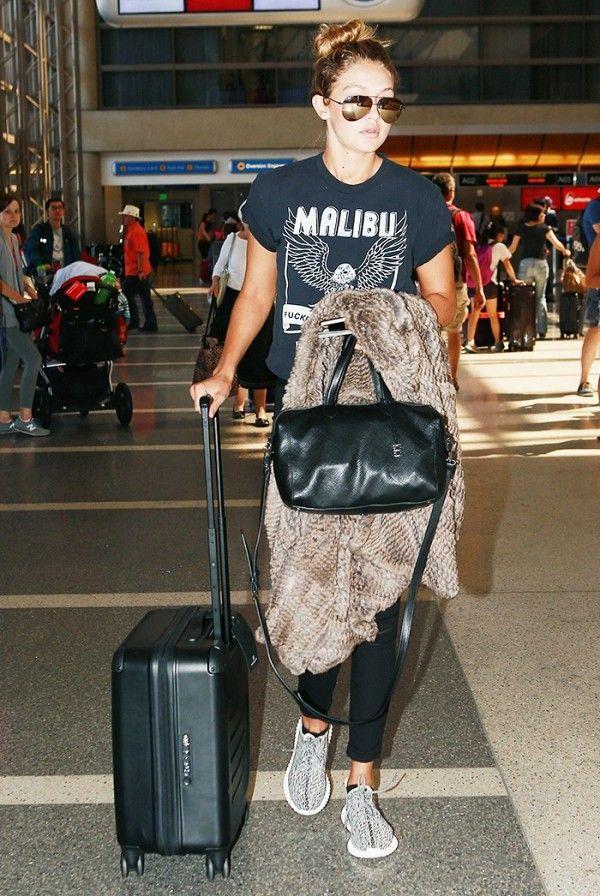 Gigi Hadid uses a carry on