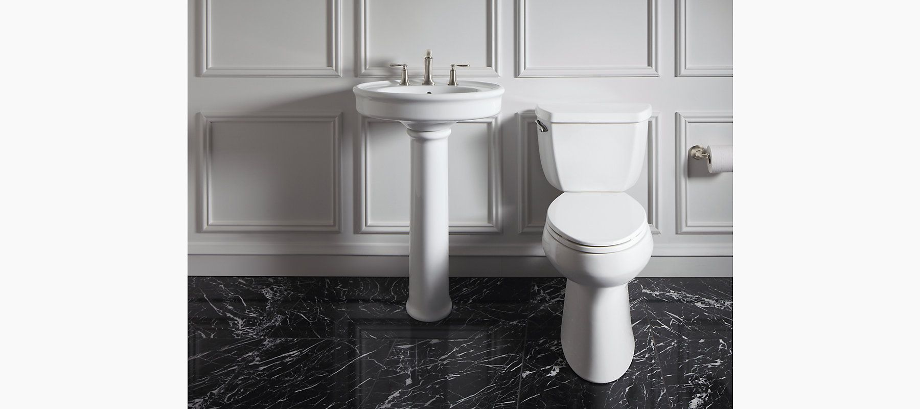 The K-R6385-8 pedestal sink features a spacious deck, Comfort Height, and subtle design elements to fit a wide range of bathroom decors.