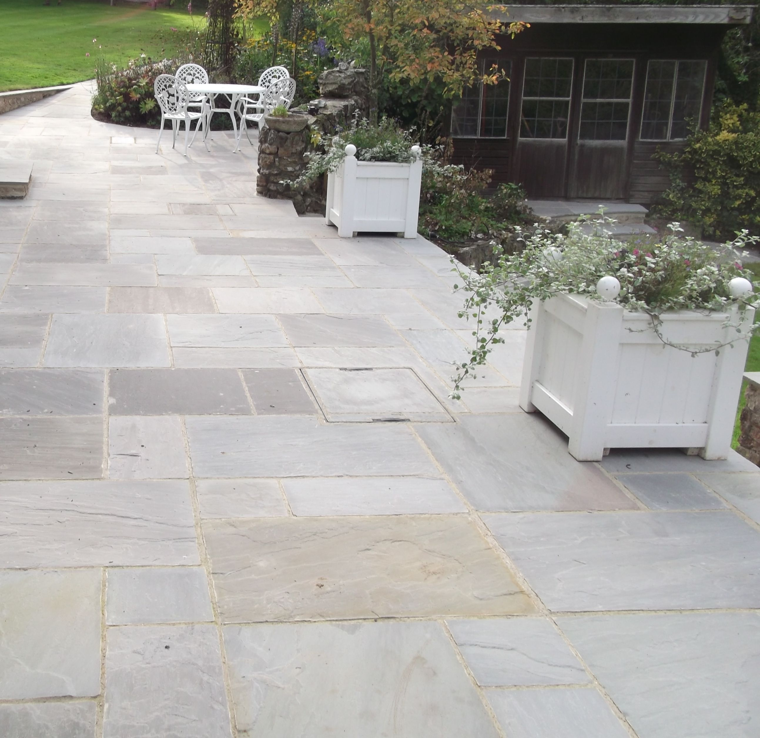 Natural indian sandstone in grey has been used to for Pictures of stone patios