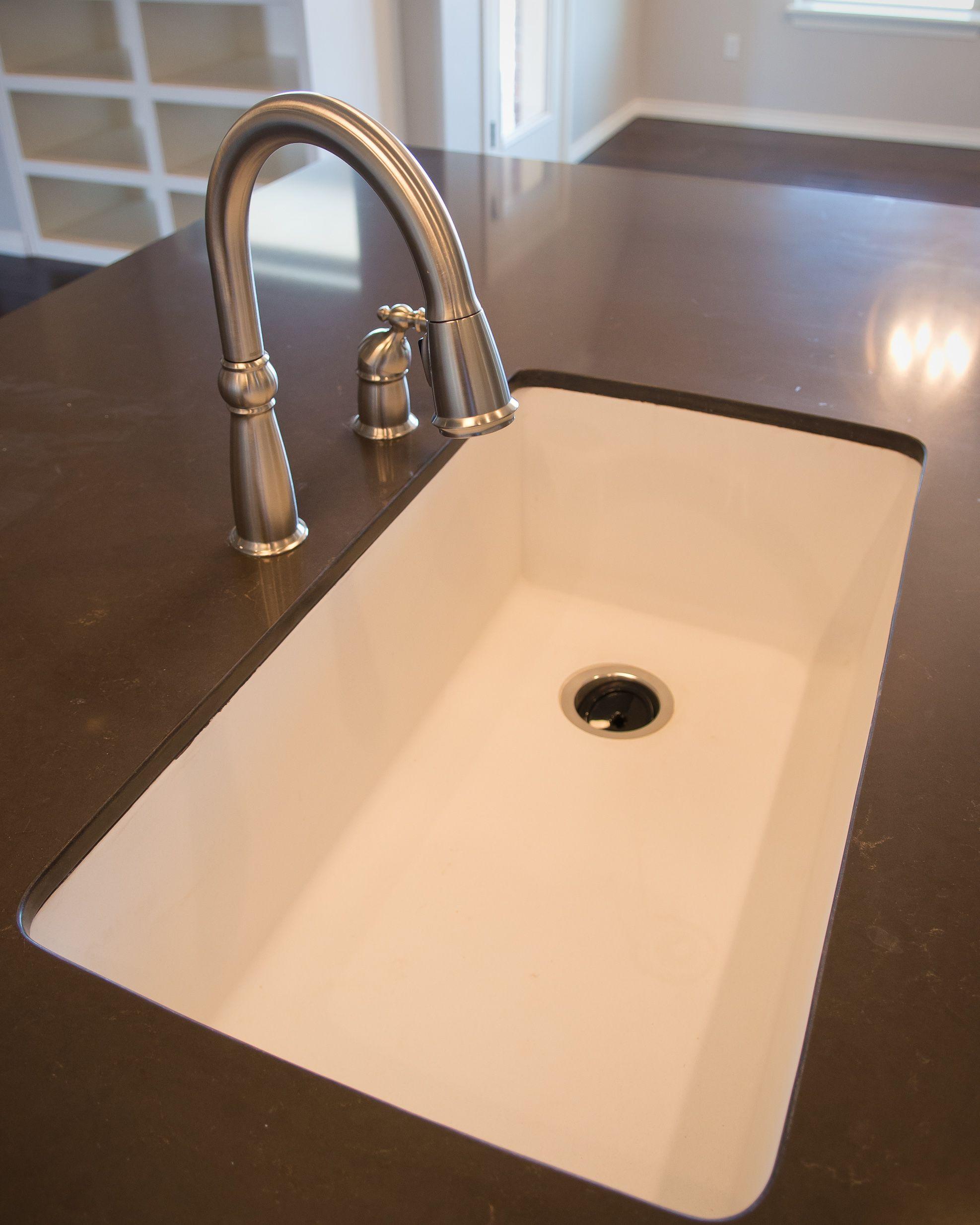 Delta leland kitchen faucet merope silestone and a white for Silestone kitchen sinks