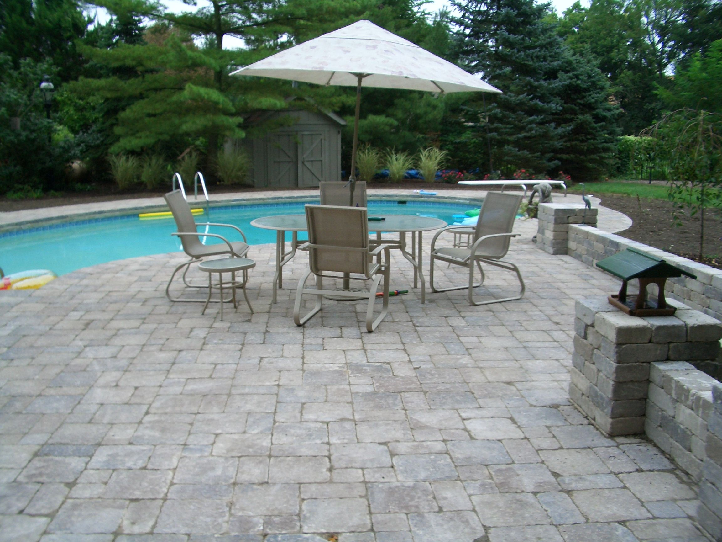 Gray paver pool patio and retaining wall Pool Deck