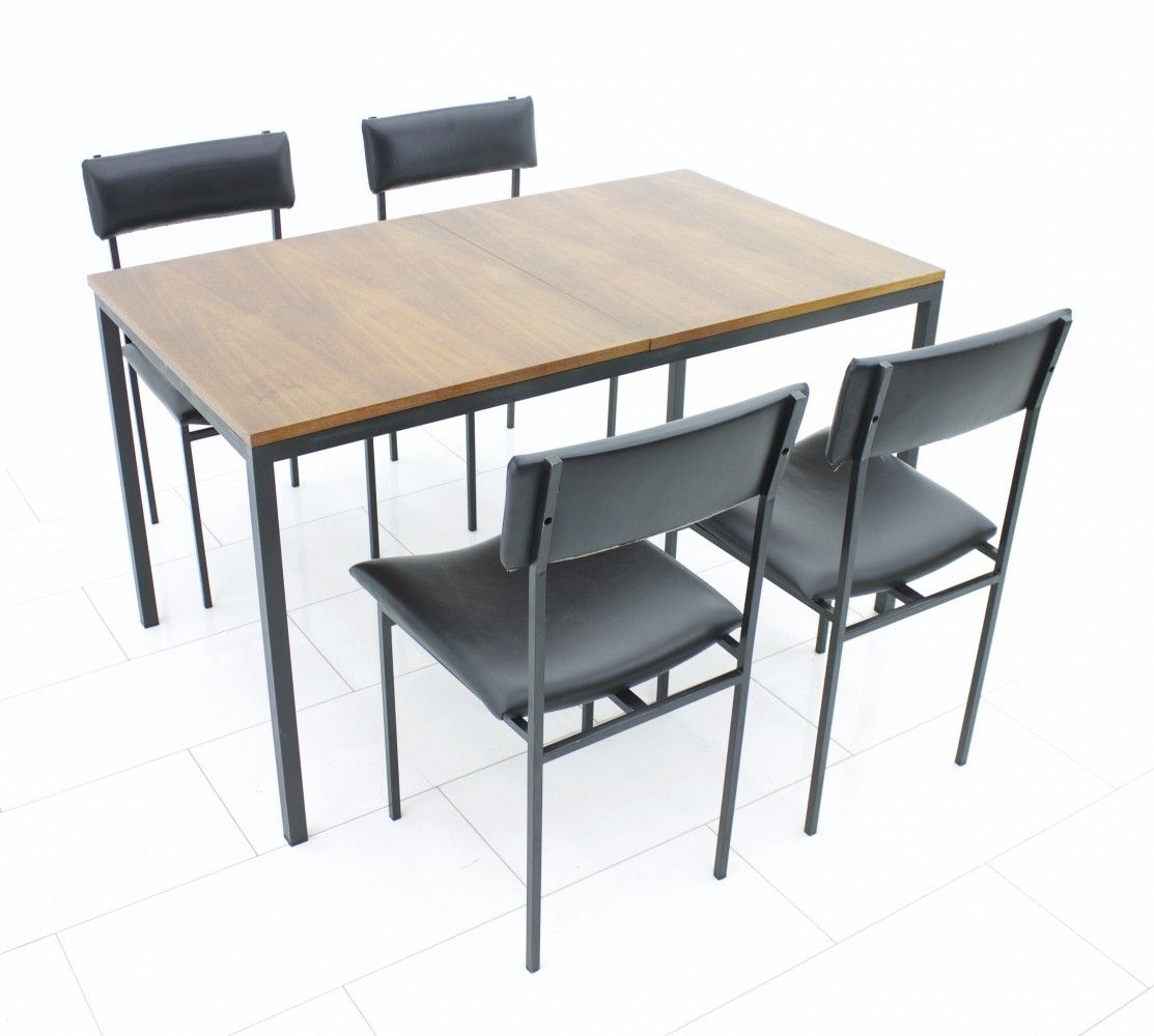 Mid century modern dining suite with a teak table u a set of four