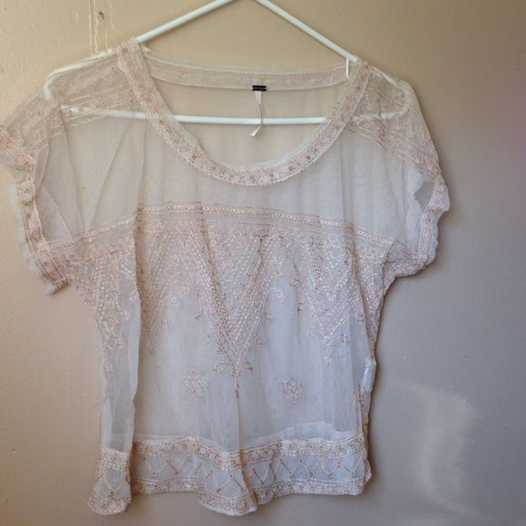 Free people mesh/lace Vicki top Mesh/ lace free people Vicki top in cream! Super delicate and pretty. Size small. Worn once Free People Tops