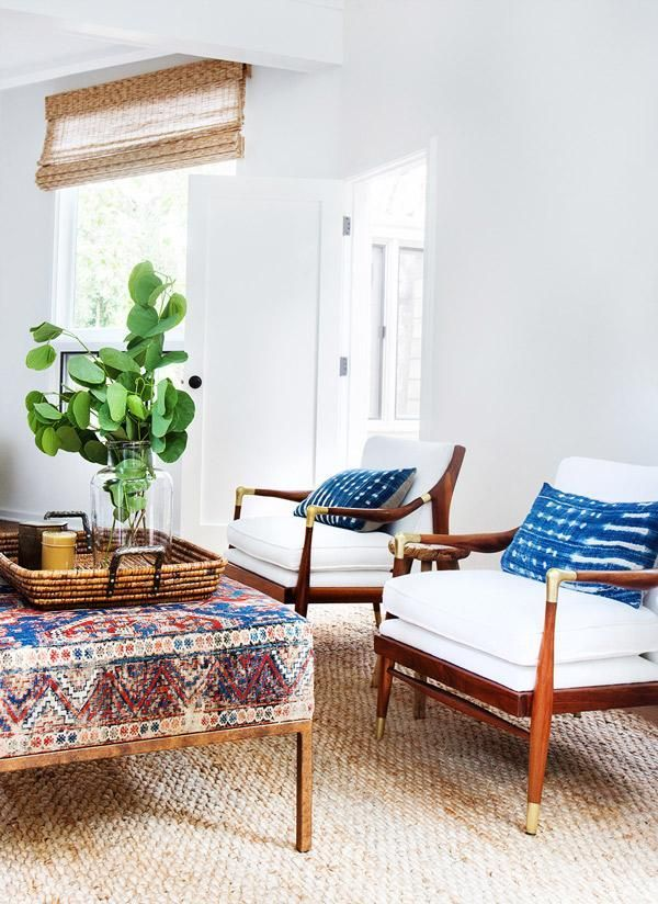 The rug-covered ottoman-slash-coffee table drew us in, and the indigo-dyed throw pillows (with their vaguely American-flag-esque patterns) kept us around. Let's hear it for unconventional textiles!