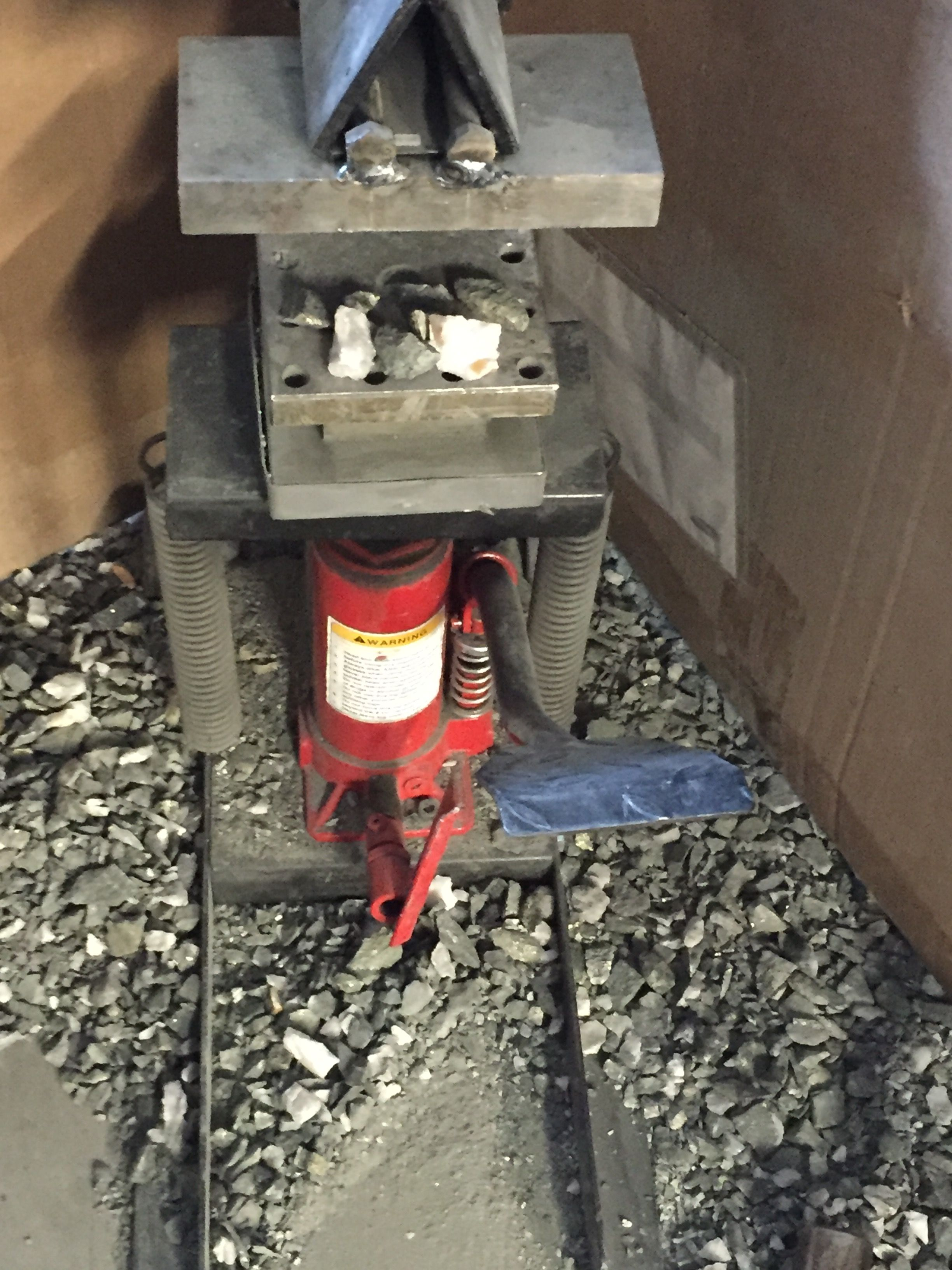 Home made rock crusher constructed from an inverted log splitter