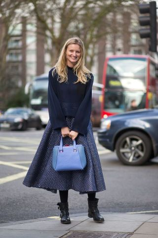 What to wear on your legs when it gets too cold to bare them: a thick midi skirt.