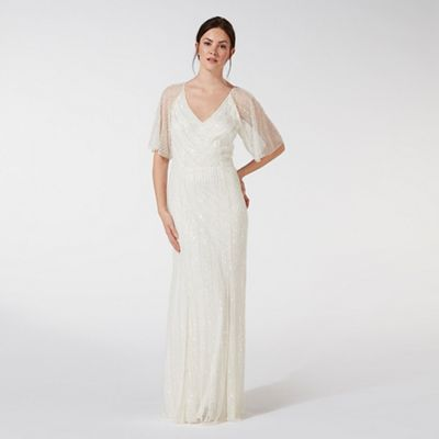 This Bridal Dress From Debut Offers A Beautiful Style And Showcases Exquisite Hand Beaded Embe V Neck Wedding Dress High Street Wedding Dresses Wedding Dresses