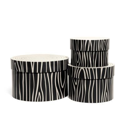 round cardboard storage boxes that can be nested boxes and lids printed to resemble a tree. Black Bedroom Furniture Sets. Home Design Ideas