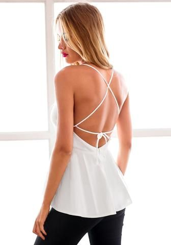 Left back view of model in white empire-waist spaghetti-strap top