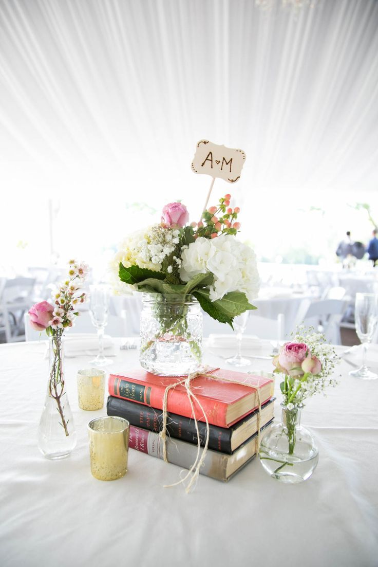 Vintage books make a great centerpiece. Perfect for a book-lovers ...