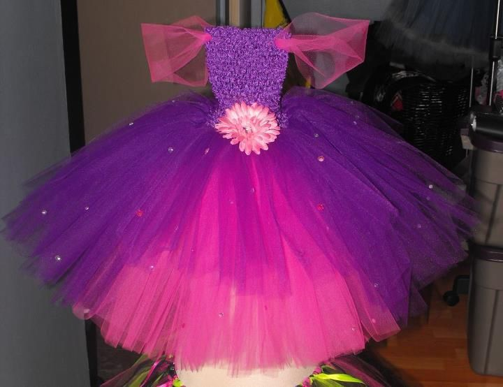 Tangled inspired tutu dress complete wit cap sleeves, added bling and pink flower clip