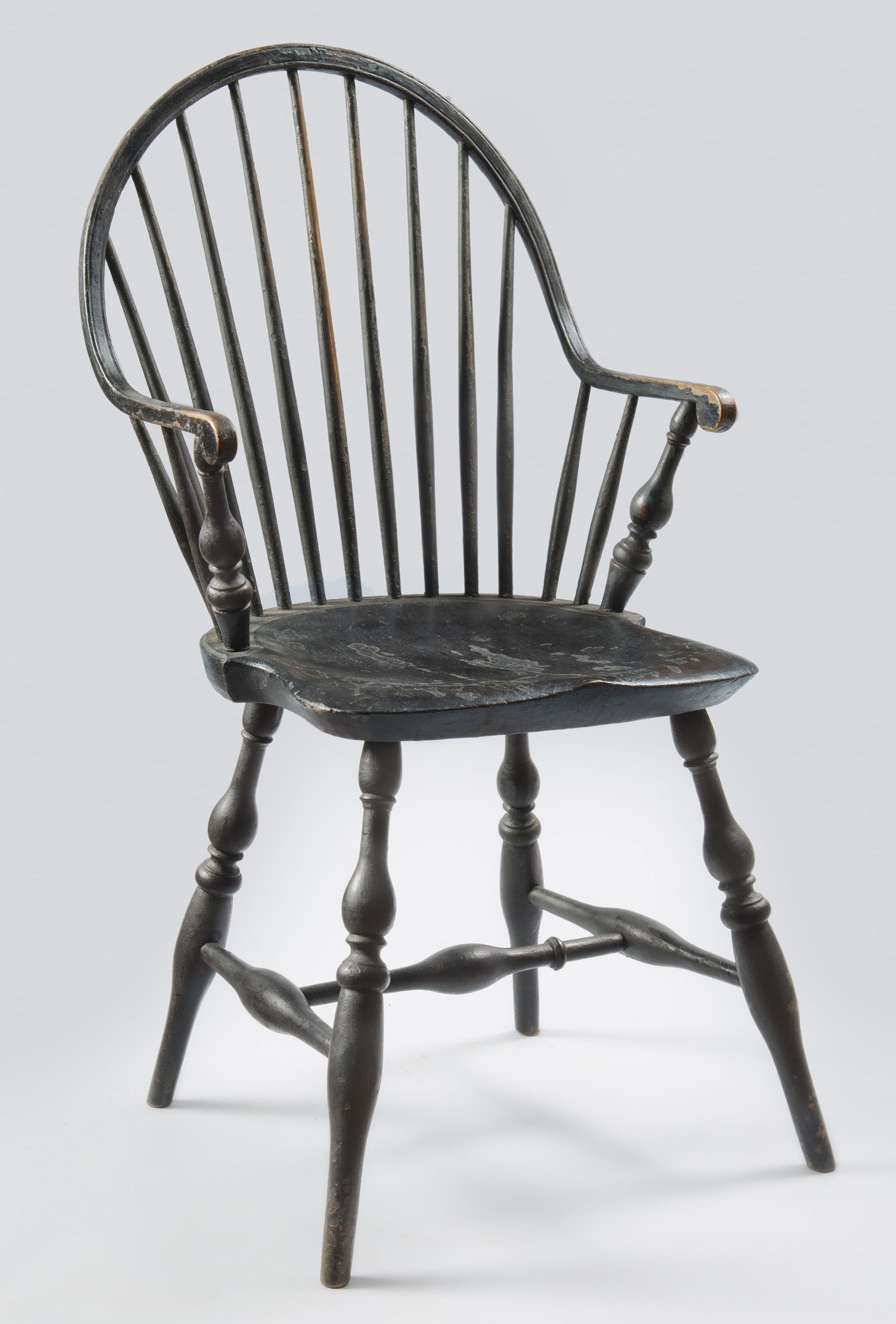 Blackpainted windsor continuous armchair with rare
