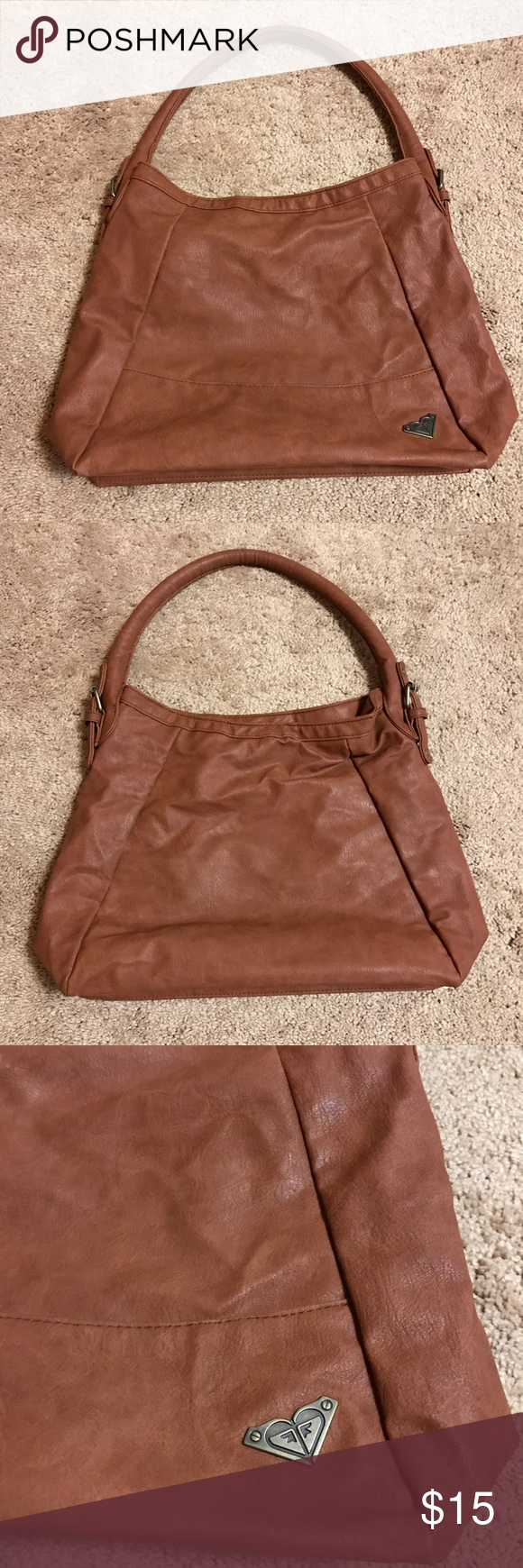Roxy Shoulder Bag Selling a gently used tan Roxy Shoulder Bag.  3 pockets inside (one of them being zippered and the other two are open at the top). Tan in color and made out of faux leather. Roxy Bags Shoulder Bags