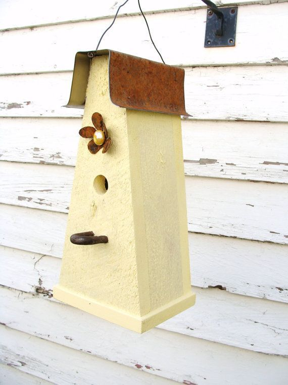 Rustic yellow birdhouse with metal flower accent for your garden or ...