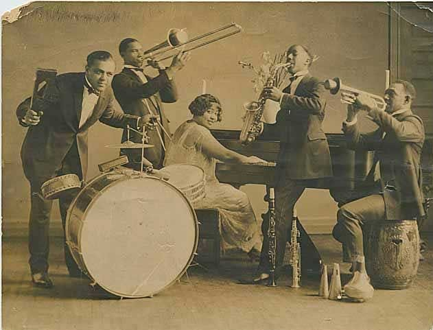 Seattle's jazz culture flourished in the 1920s and 1930s, particularly in the multiracial neighborhood culture of Jackson Street in Seattle's Central District. Pictured here is Edythe Turnham and her Knights of Syncopation, c. 1925.