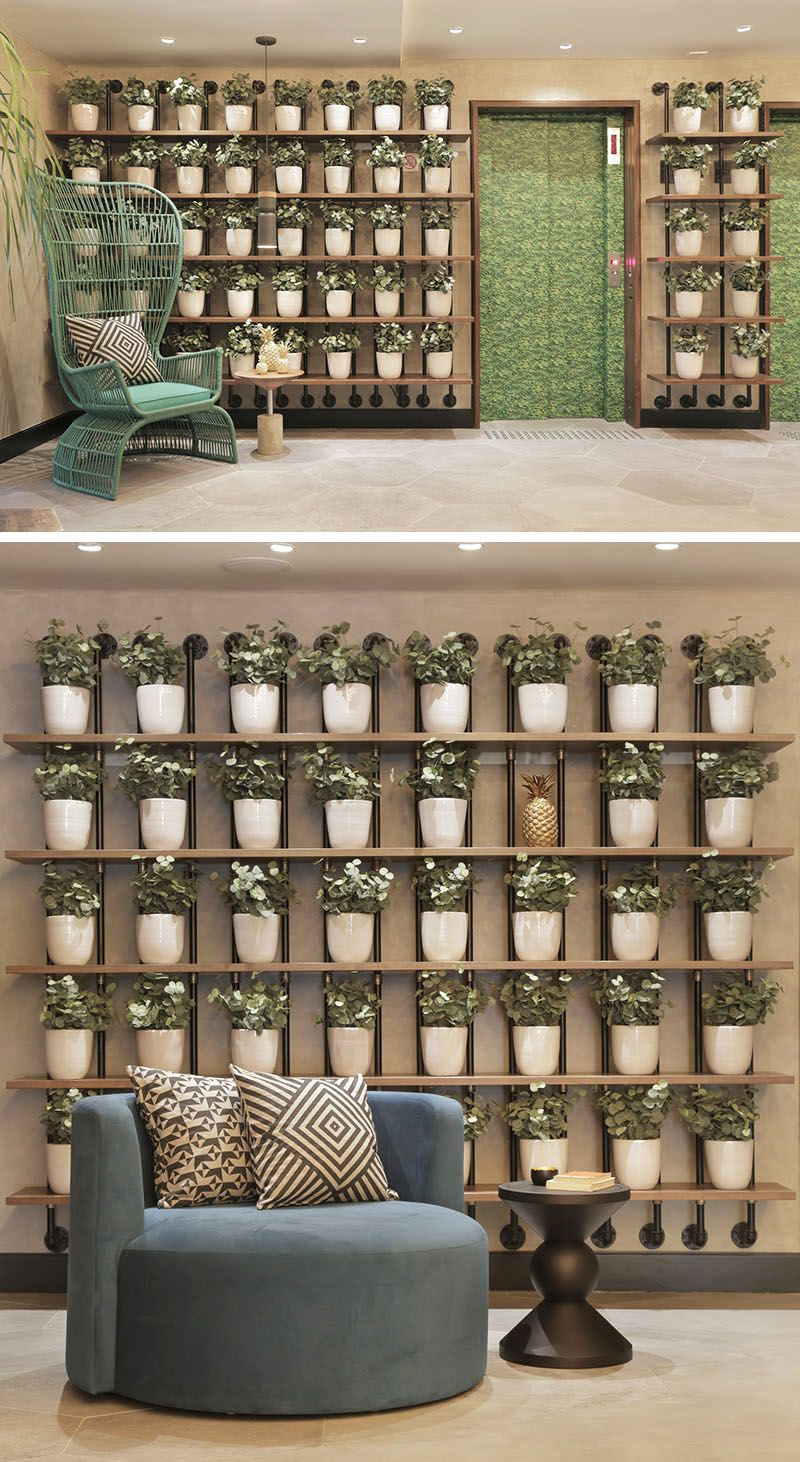 wall decor idea create a grid of planters on a shelving unit for a