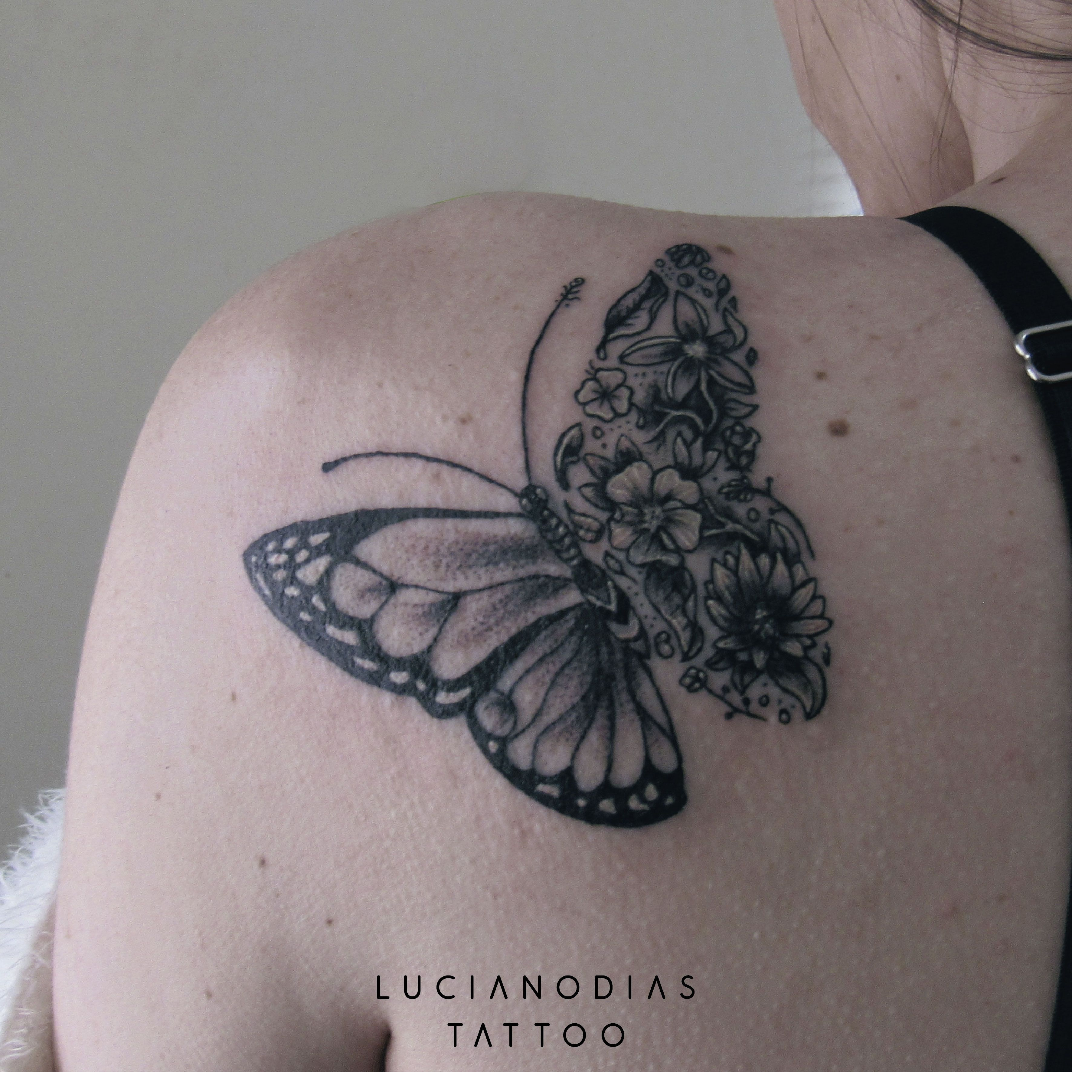 84f5a14cd97e9 Half butterfly, half flowers blackwork tattoo made by me at the Black Box  Studio.