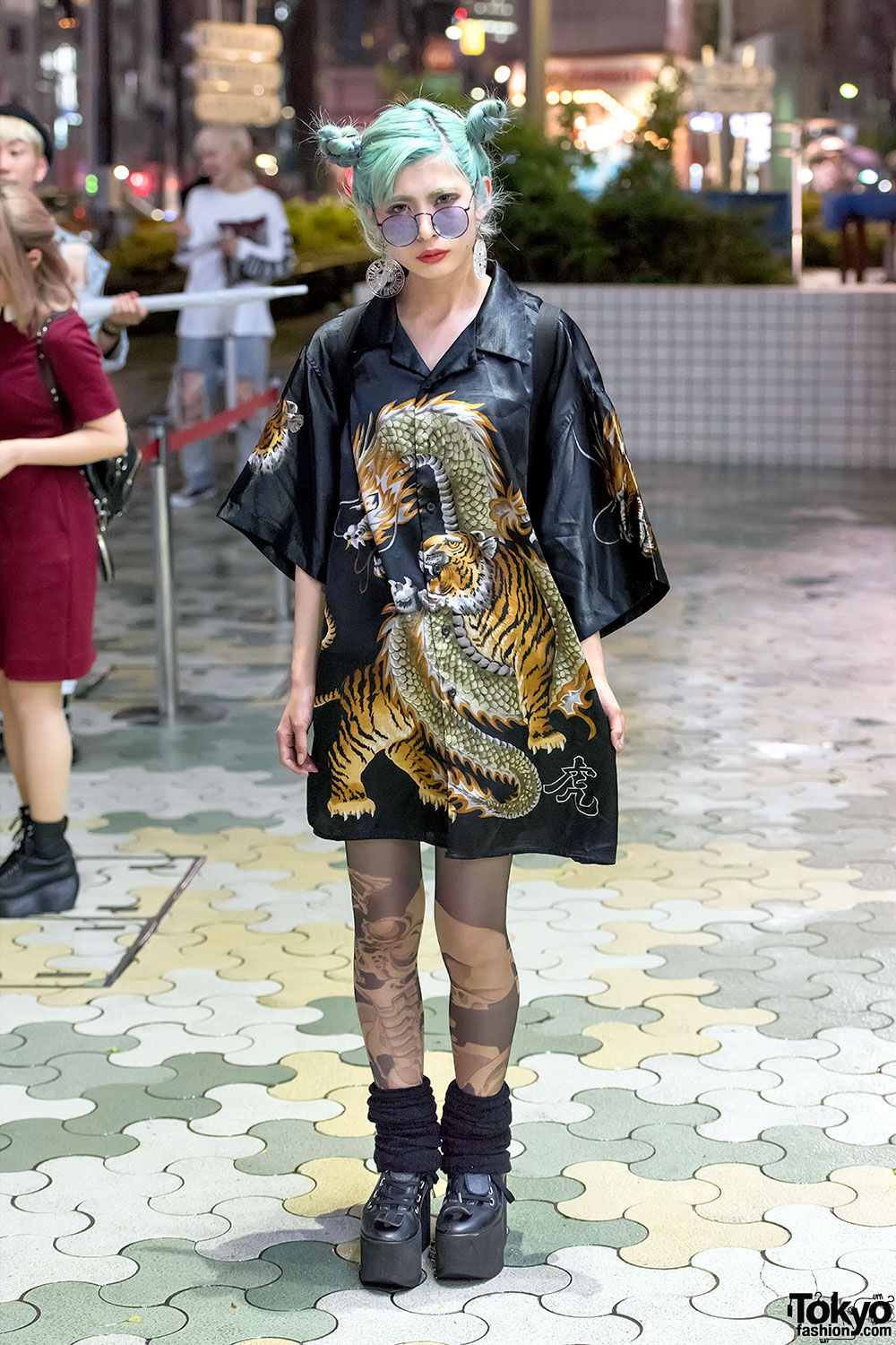 Ena on the street in Harajuku wearing a dragon vs tiger shirt dress from  Dog Harajuku, Avantgarde Harajuku tights, Tokyo Bopper platforms, MYOB NYC  earrings ...