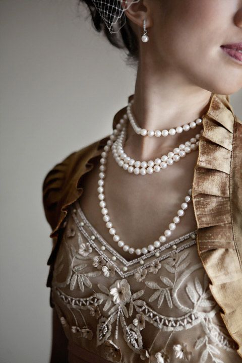 Jane. A leash of pearls cuts deep into her flesh. A visible yet invisible chain.