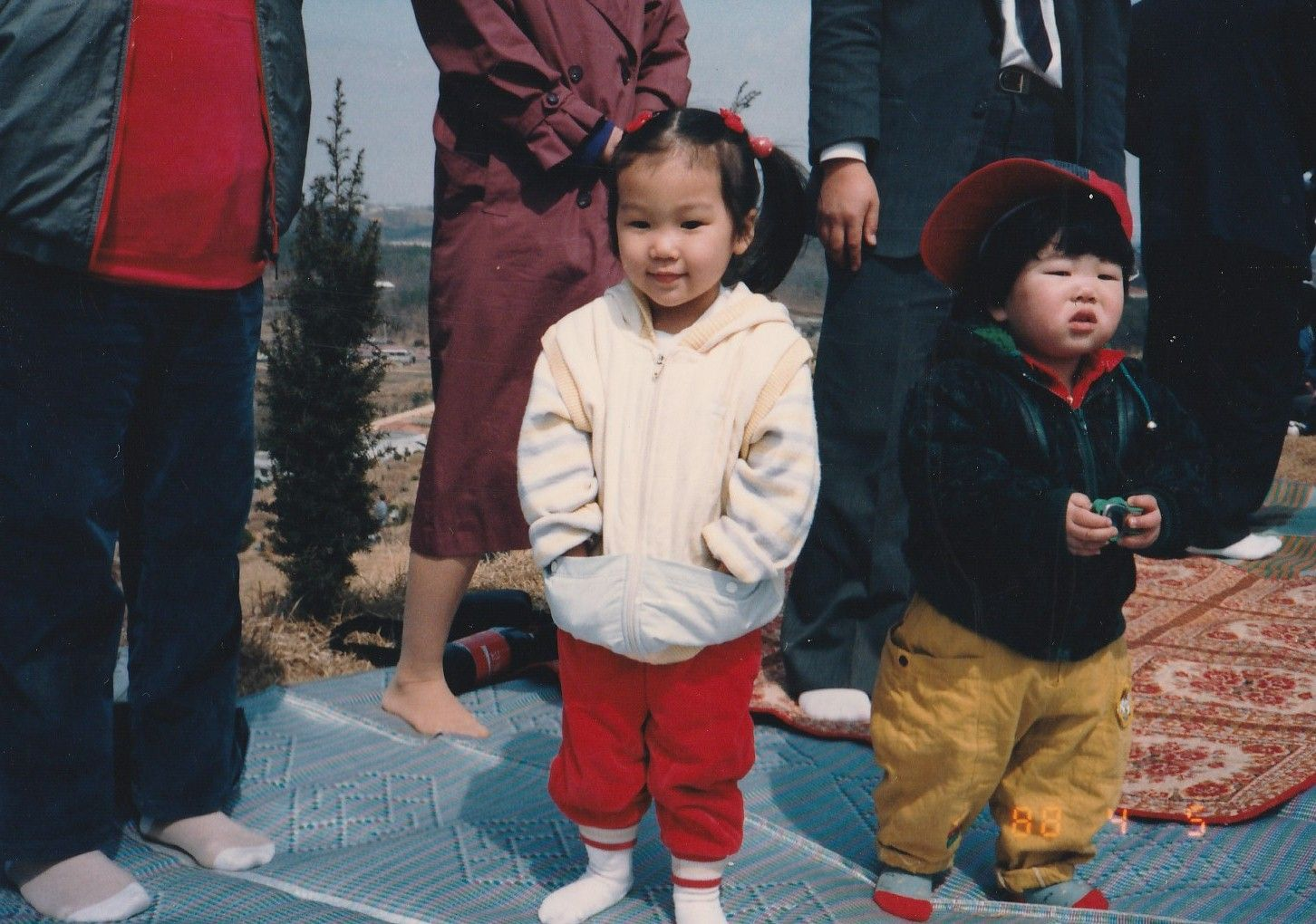 When I was young. With relatives and cousin HyunGyu Kim at the family cemetery mountain on a national holiday in autumn.