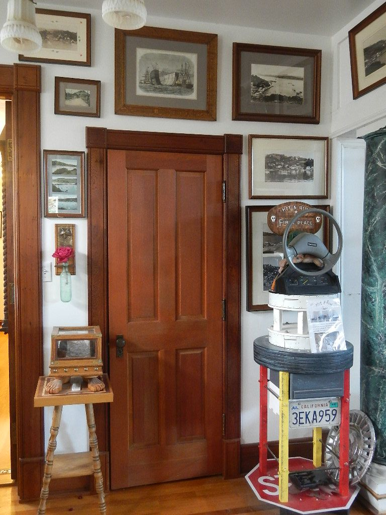 Entry with art and wood door artest home embesishments