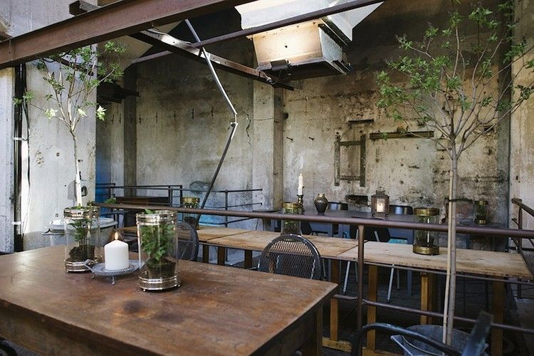 distressed concrete walls and exposed structural beams overhead reinforce the industrial character of the space cafe interiorcafe restaurantrestaurant - Concrete Cafe Interior